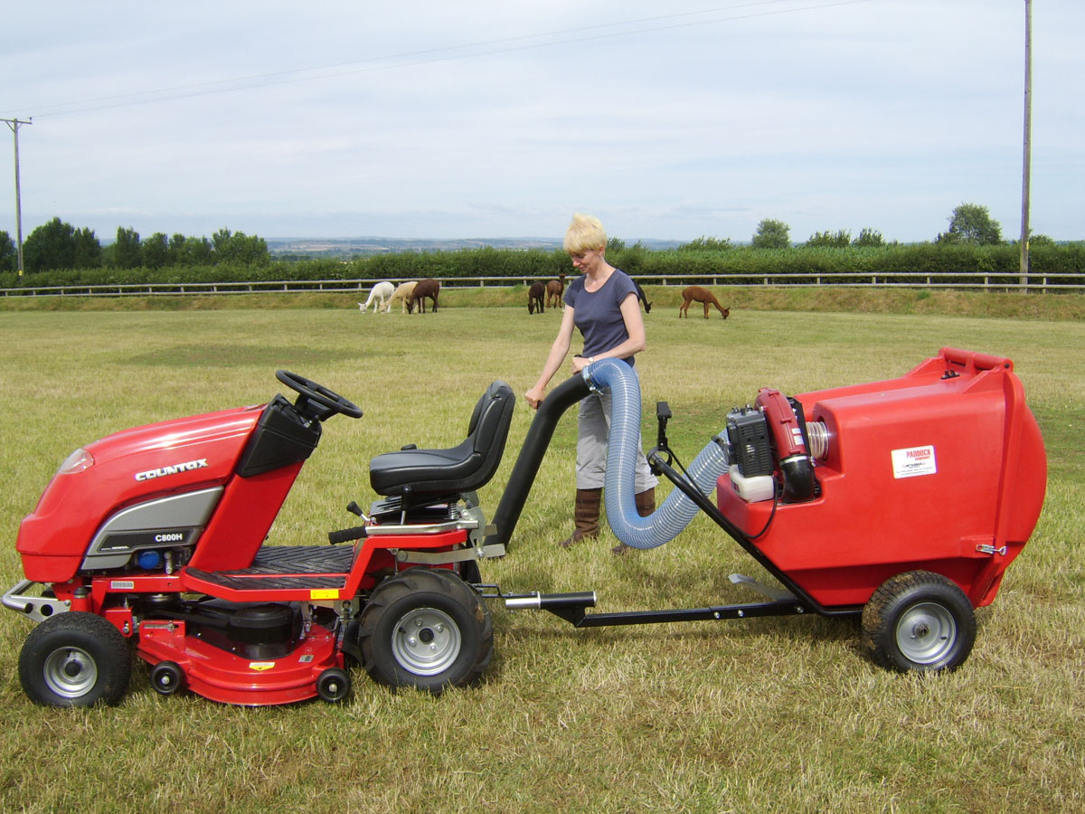 Field vacuums towed by a ride-on mower